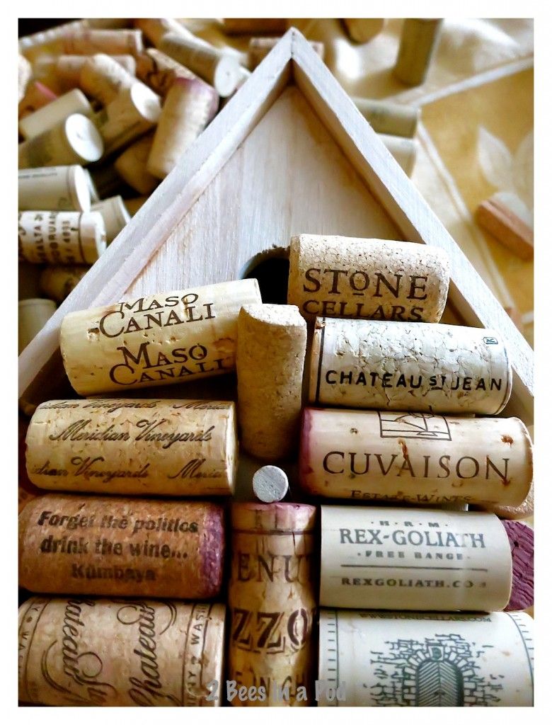 Cut wine corks to fit around hole opening for the birdhouse. It's best to lay out the corks and play around with them.
