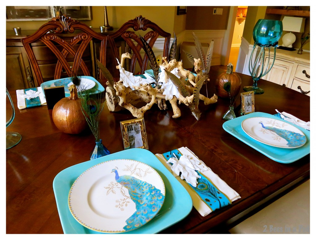 Turquoise and copper Fall tablescape. Vintage elements of inkwells, framed photos, aged wine vine, copper painted pumpkins and white plaster leaves.