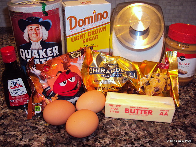 Ingredients for monster cookies: butter, vanilla extract, peanut butter, oats, sugar, eggs, chocolate chips and M&M's