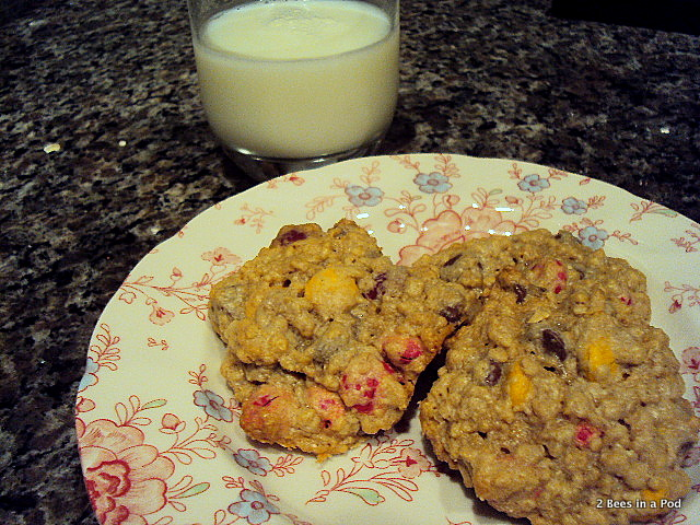 Monster Cookies with milk (contains sugar, oats, peanut butter, chocolate chips, and M&M's) Perfect for Halloween!
