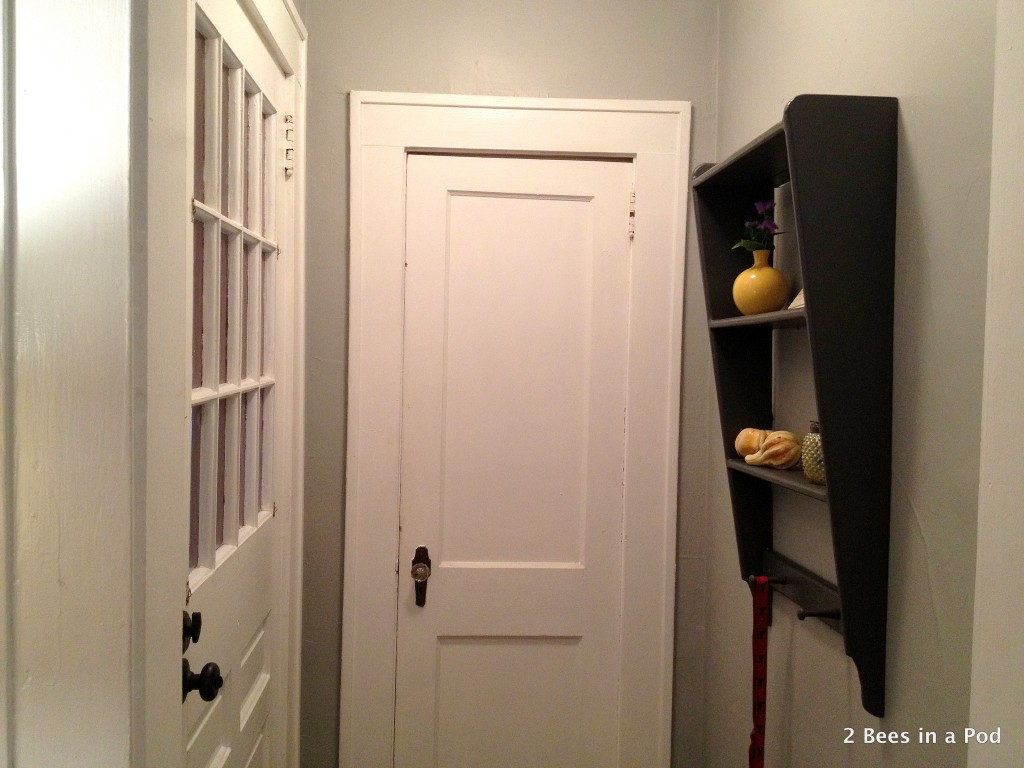 Entry Way with new shelf I painted dark grey and added yellow accent pieces.