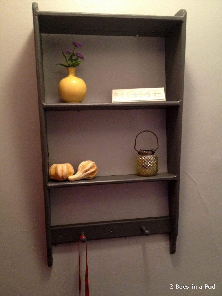 Shelf After with dark grey paint and yellow accent pieces.