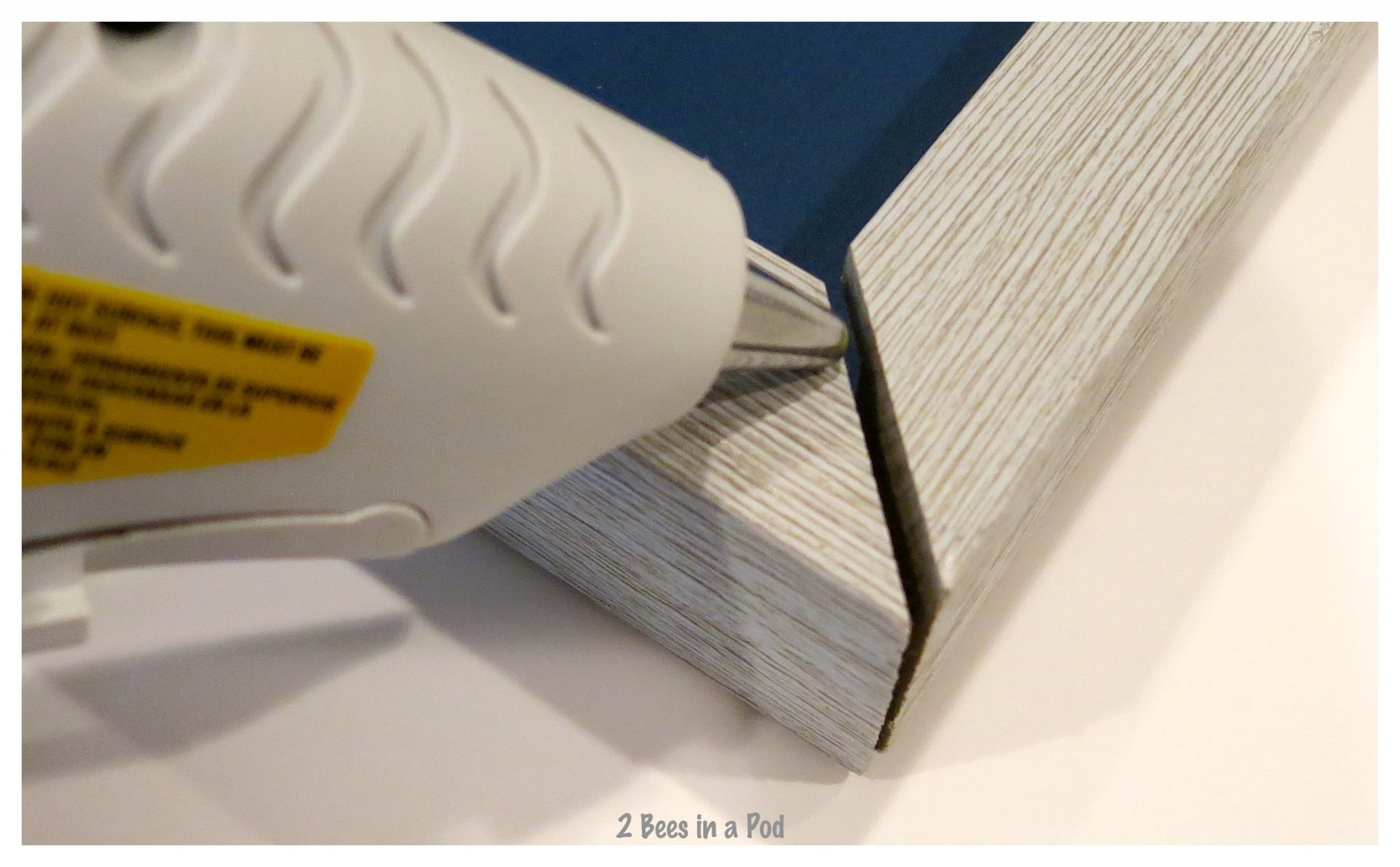 Hot glue was used to repair the corners.