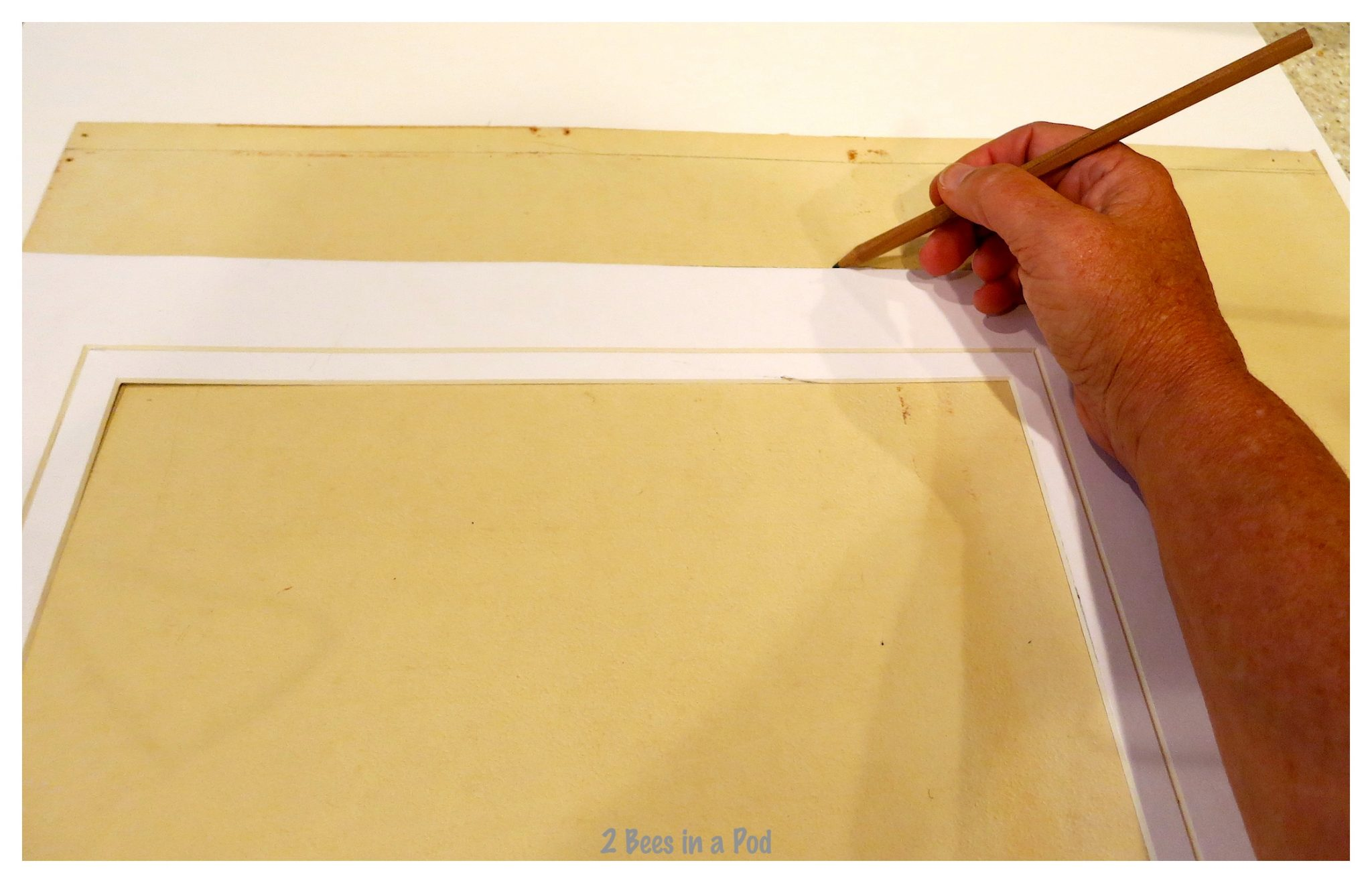 Cutting out the foundation backing for the pocket board project. Repurposed and Transformed a 10 cent garage sale frame.