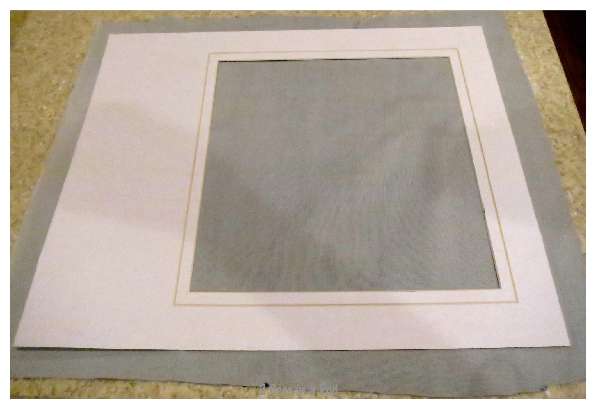 Cutting the fabric for the repurposed picture frame.  Created a pocket board in just 15 minutes.