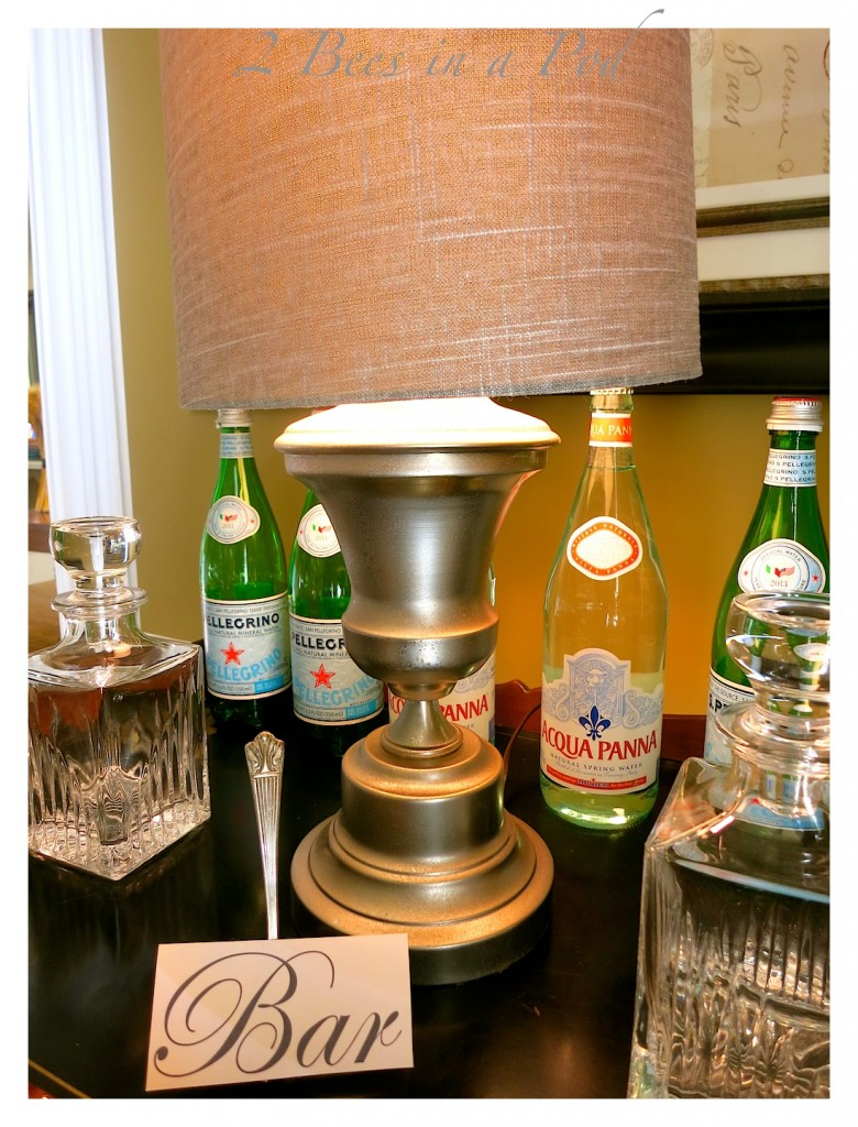 Take an old brass lamp and turn it into a DIY Mercury Glass lamp - spray paint, vinegar and water give you this beautiful - aged look. Great in the bar area.