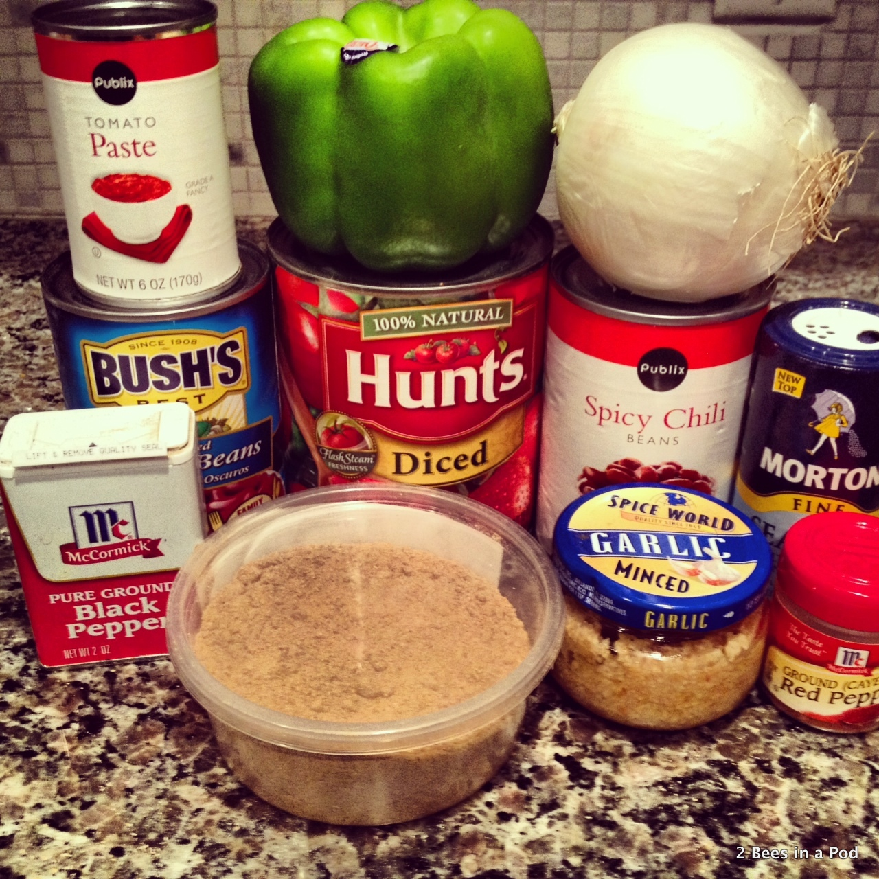 1-Ingredients for homemade chili with diced tomatoes, kidney beans, chili beans, onion, green pepper, cumin
