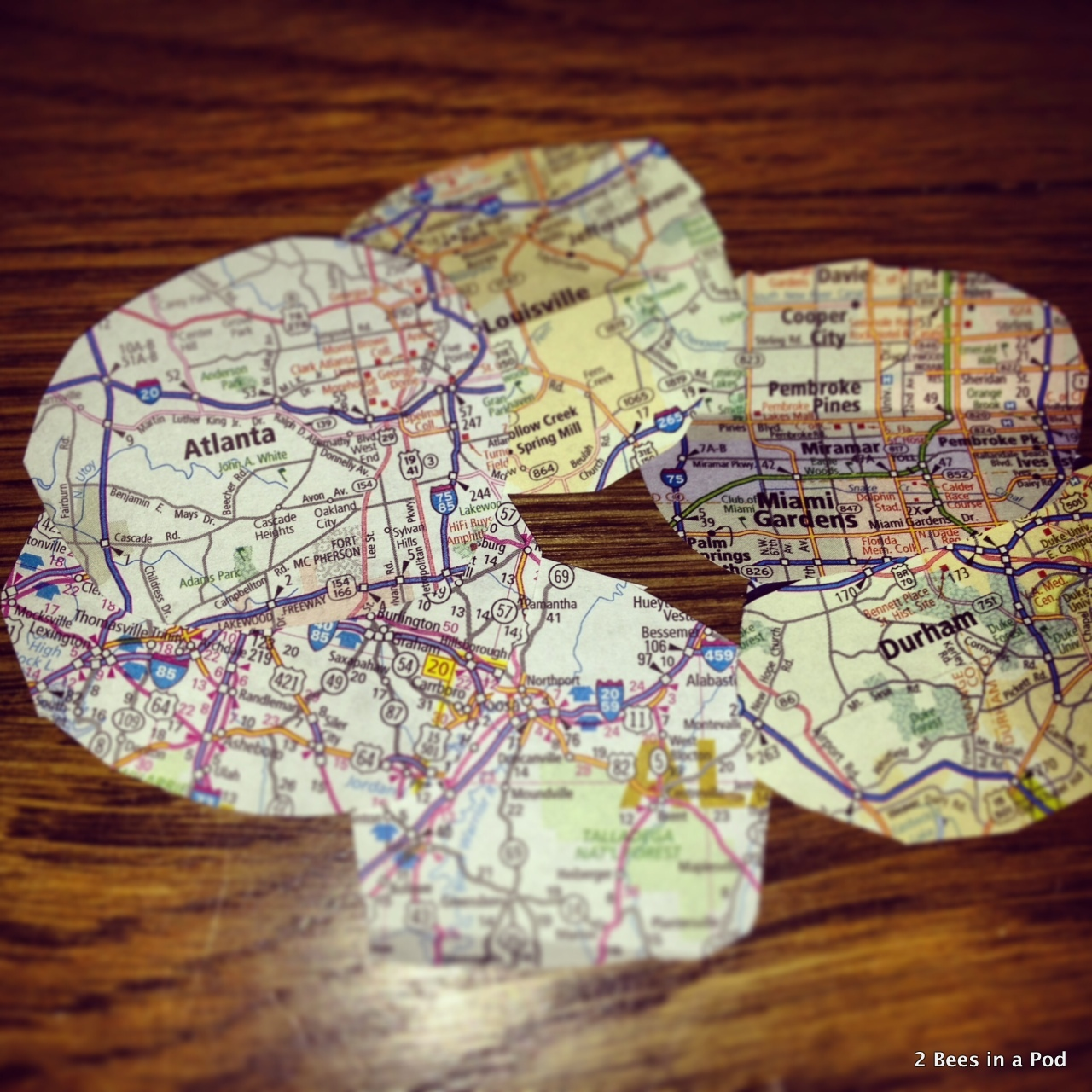 1-Maps cut into oversized circles