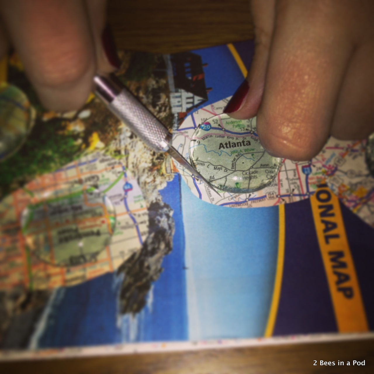 1-Using the exacto knife to get the excess map off