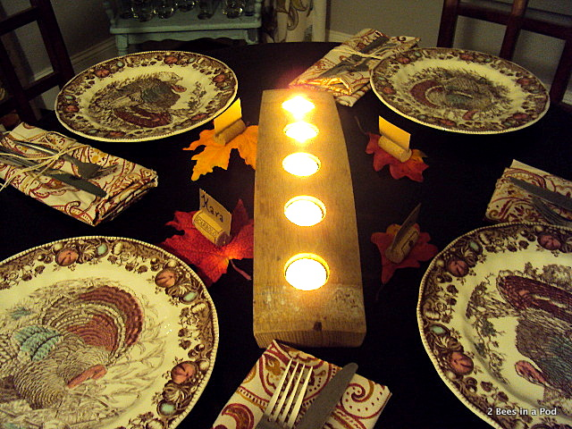 Fall Tablescape with turkey plates, cork place cards, rustic candle holder, Cynthia Rowley napkins, twine