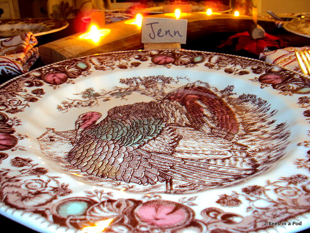 Fall table setting with turkey plates from Replacements by Johnson Bros., Cynthia Rowley napkins, twine, and DIY cork name place