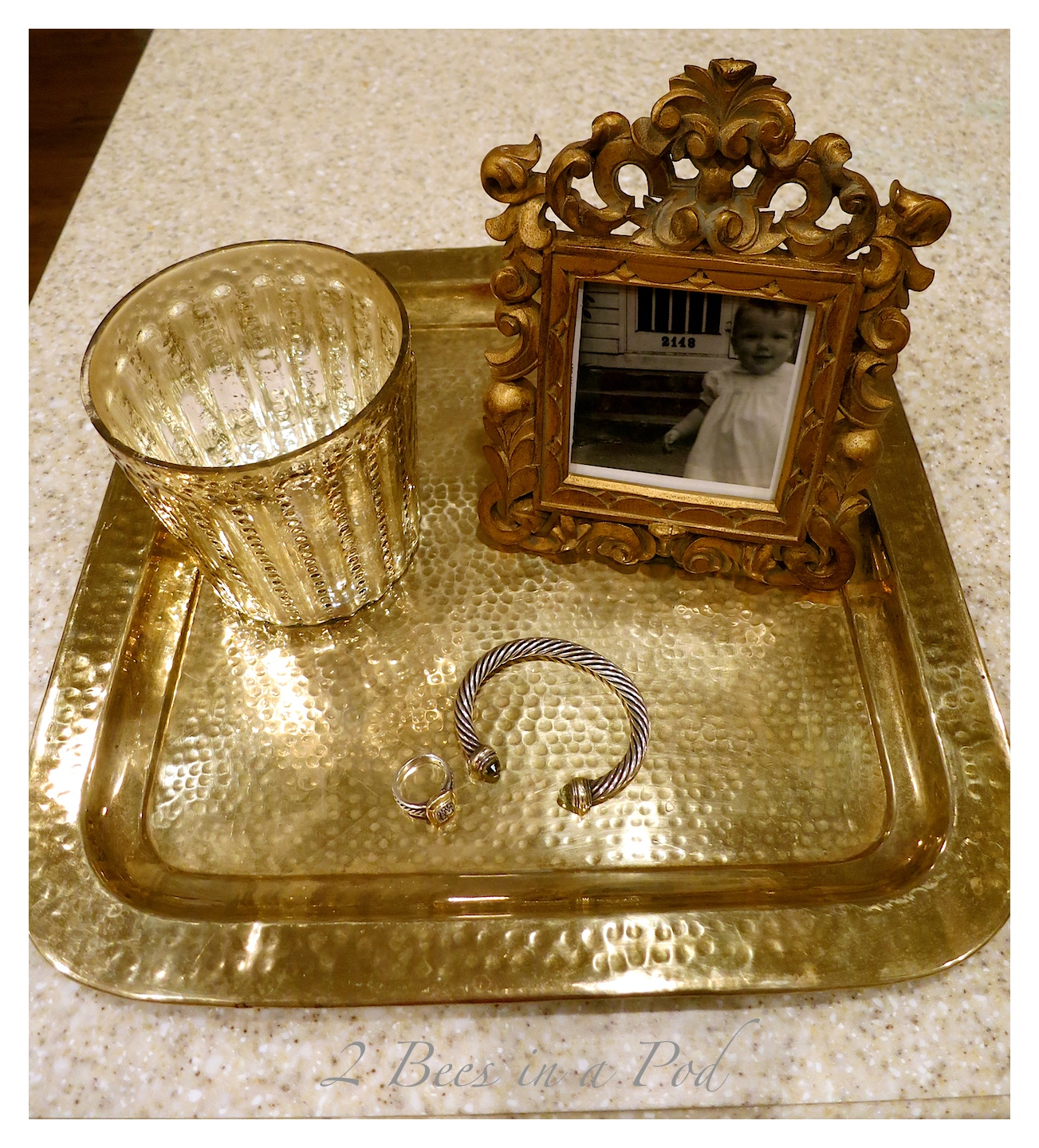 This pretty Hammered brass tray was a 10 cent thrift store find.  It was brought back to life with just a little brass cleaner.