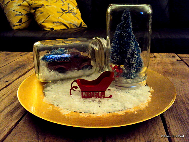 Christmas vignette with mason jars, red vintage truck, noel sleigh, miniature trees, and fake snow