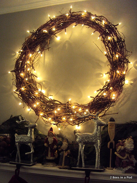 Grape vine wreath with lights for rustic Christmas mantle