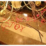 DIY hand painted Christmas table runner for the dining room. I chose to paint JOY as my message :) I love the rustic burlap.