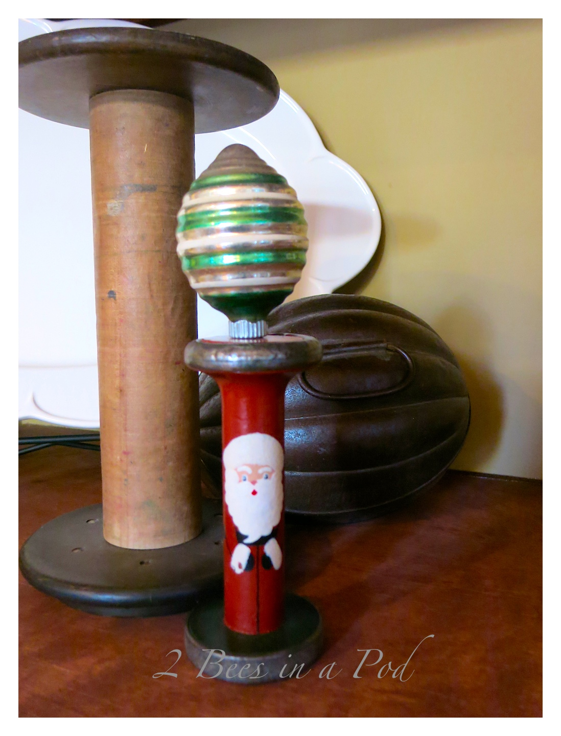 Rustic Christmas - I love the crusty, rusty, chippy and warmth that rustic elements bring to my home for Christmas!The old spools are so warm. I painted the Santa on the miniature spool.