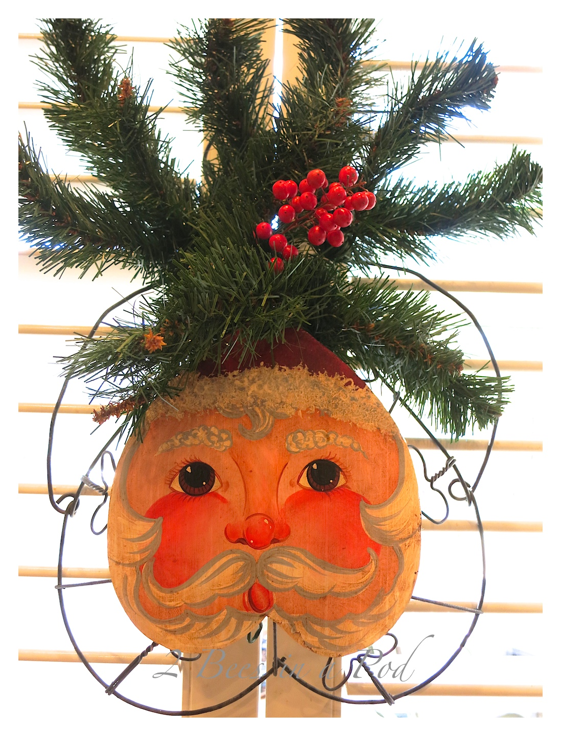 Rustic Christmas - I love the crusty, rusty, chippy and warmth that rustic elements bring to my home for Christmas! This hand painted Santa used to be a basket.