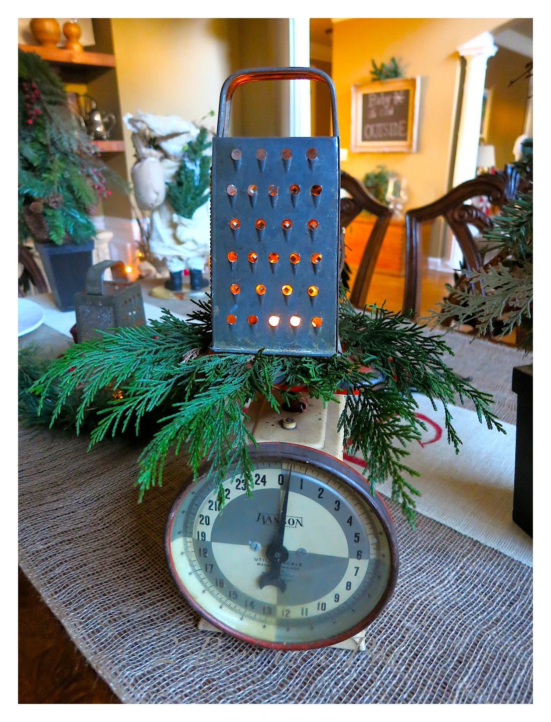 Rustic Christmas - I love the crusty, rusty, chippy and warmth that rustic elements bring to my home for Christmas! This vintage kitchen scale and grater make a wonderful tea light sconce.