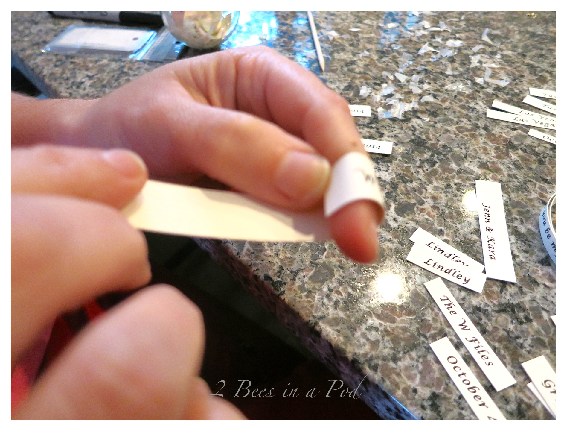 Using my finger to make the paper round to contour to the ornament