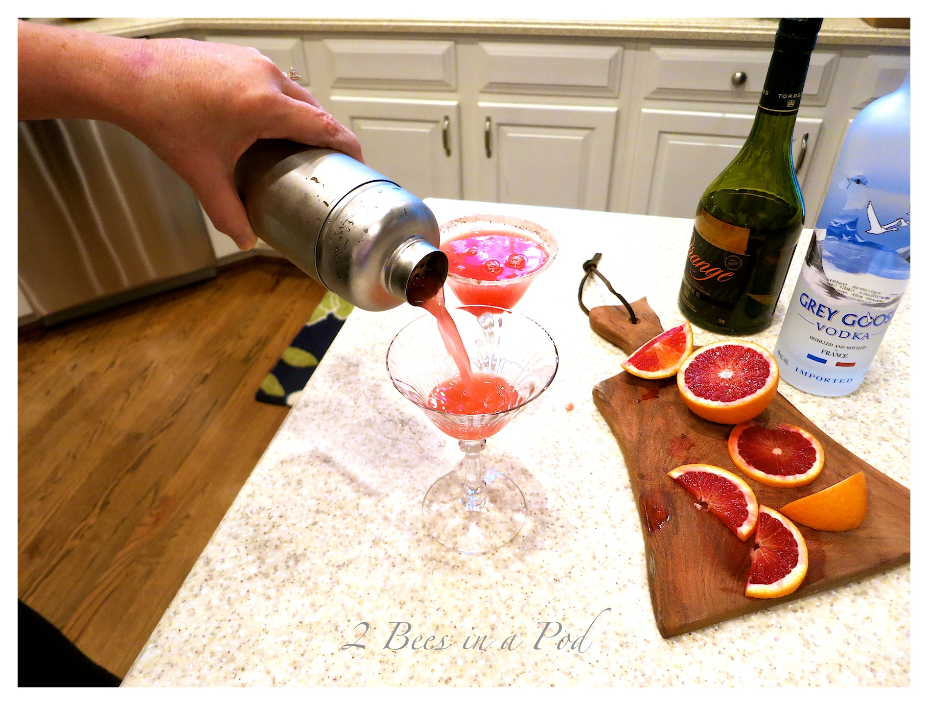 Yummy Blood Orange Martini - the perfect Christmas cocktail. Fresh squeezed Blood Orange juice, vodka, orange liquor and simple syrup.