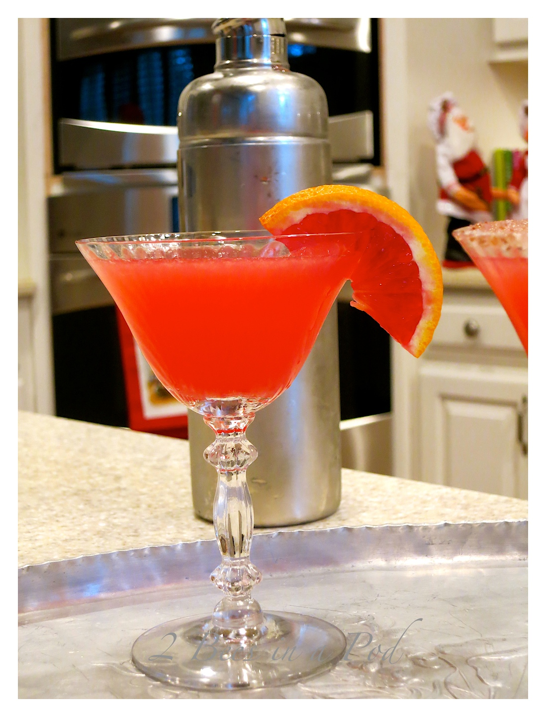 Yummy Blood Orange Martini - the perfect Christmas cocktail. Fresh squeezed Blood Orange juice, vodka, orange liquor and simple syrup.