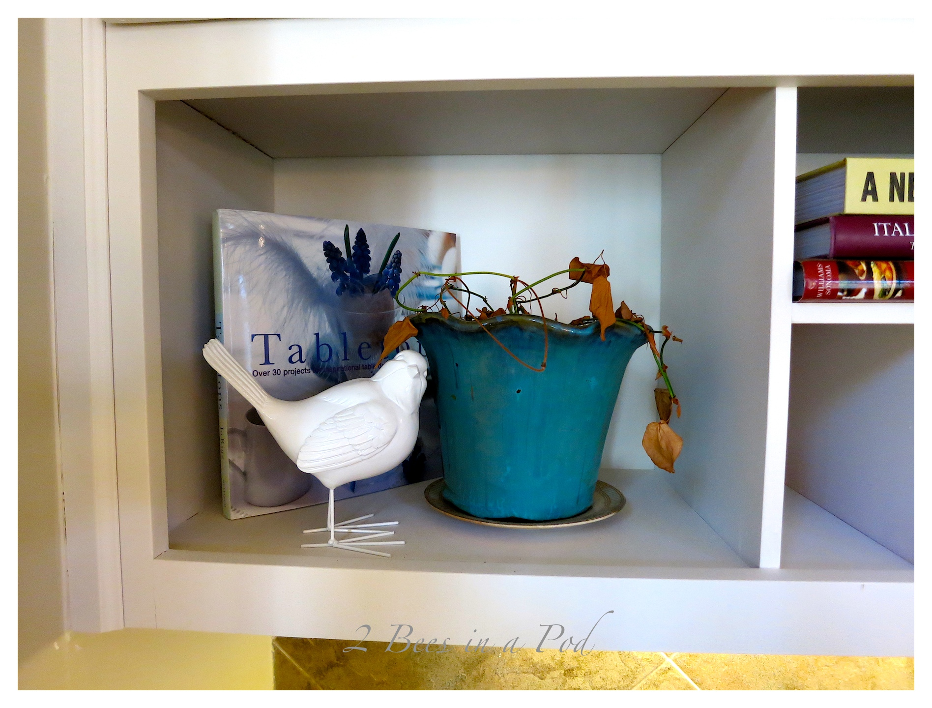 Kitchen Desk area - spruce up. Brought in aqua and turquoise glass as well as vintage items and moss.