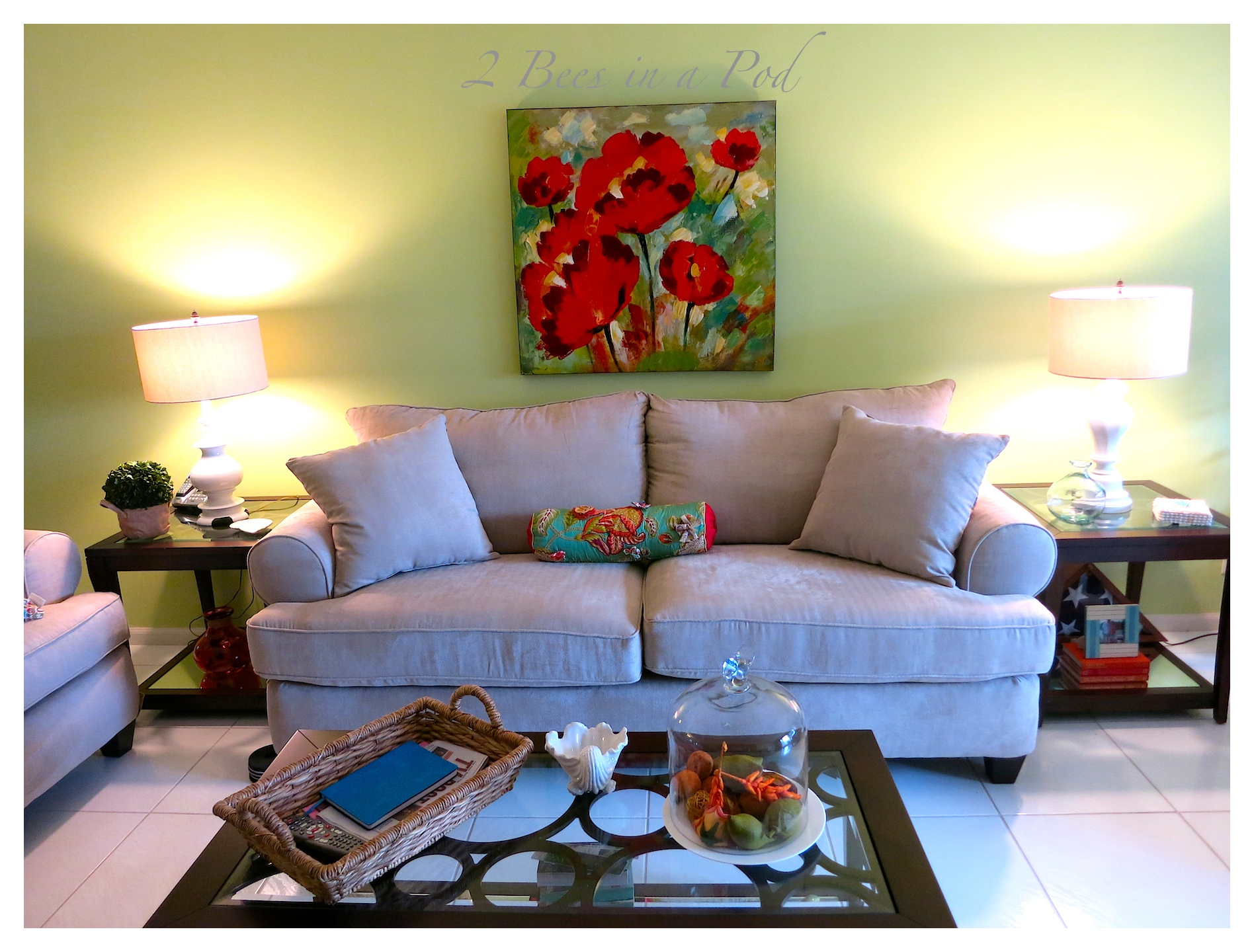 What a difference a bright paint color makes in this Palm Beach living room Makeover. Pops of green and coral and beach elements.