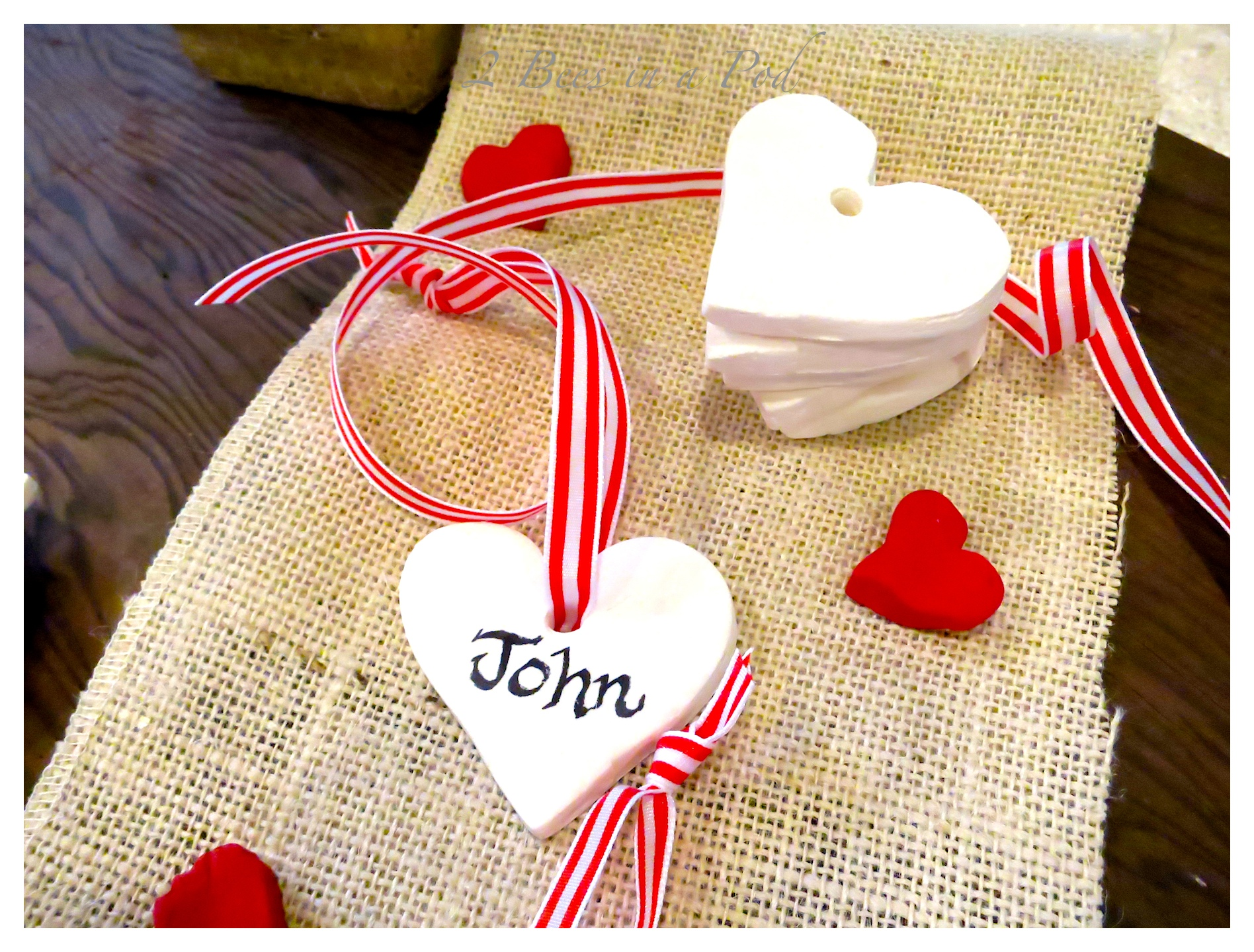 Homemade white clay gift tags for Valentines Day. Very easy to make clay using baking soda, corn starch and water. Use any cookie cutters or cutouts. Bake in the oven and the dough hardens. Very cute!!