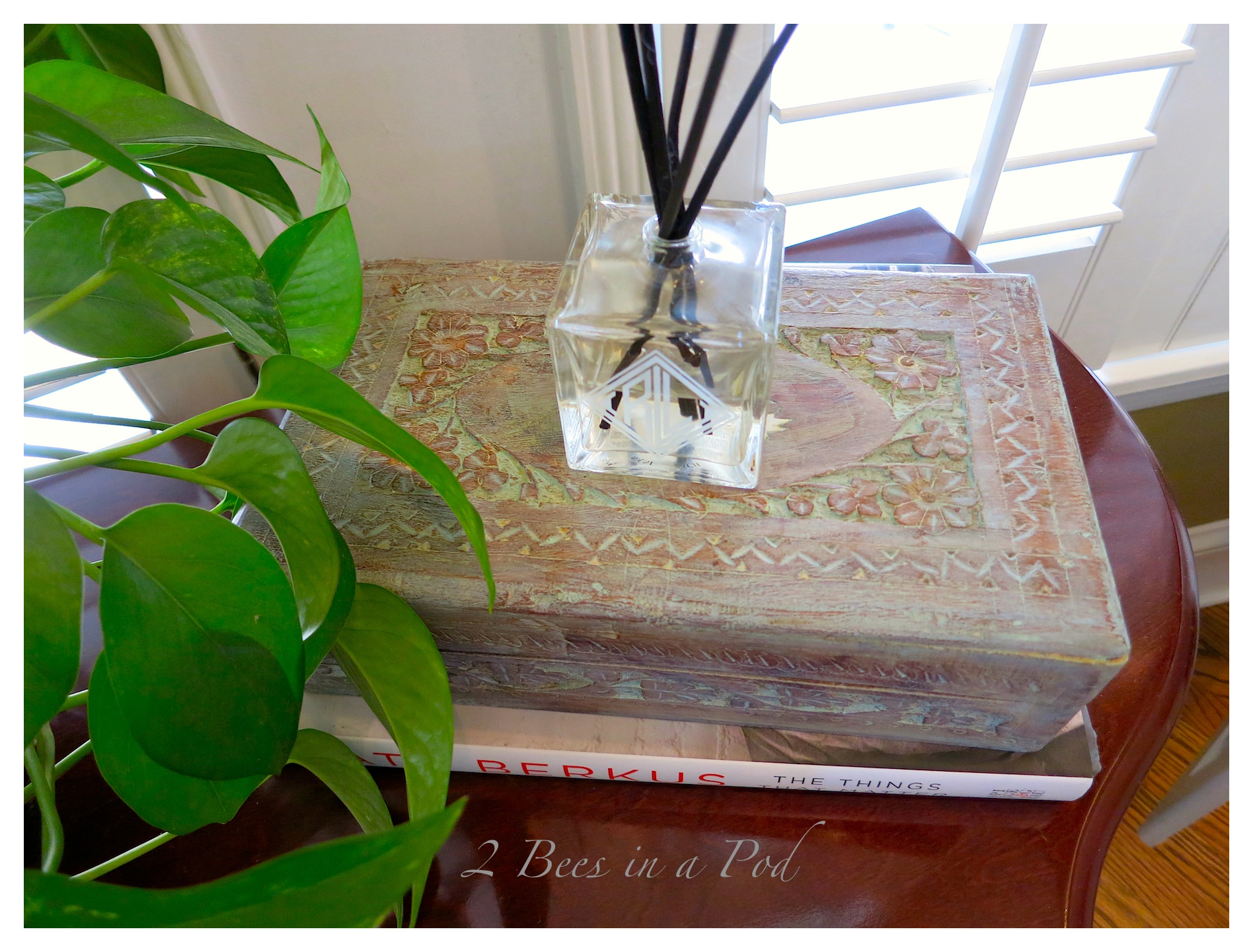 A sage gray paint-wash finish really brought out the beautiful carved details on this vintage wood box. Topped with a thin layer of paste wax and it is a beautiful display box. Makeover transformation is complete!