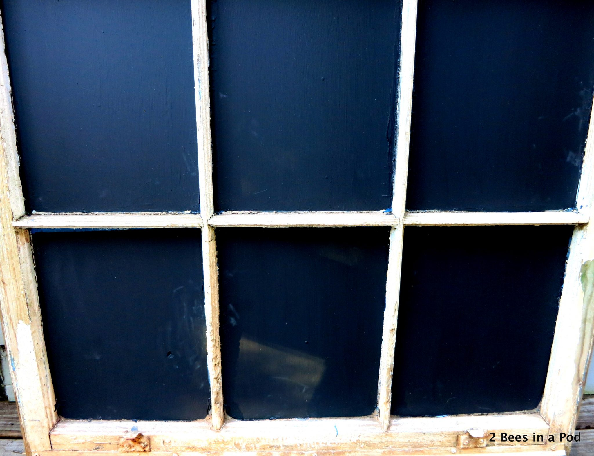 Using an old window to paint the panes with chalk paint...trash to treasure!