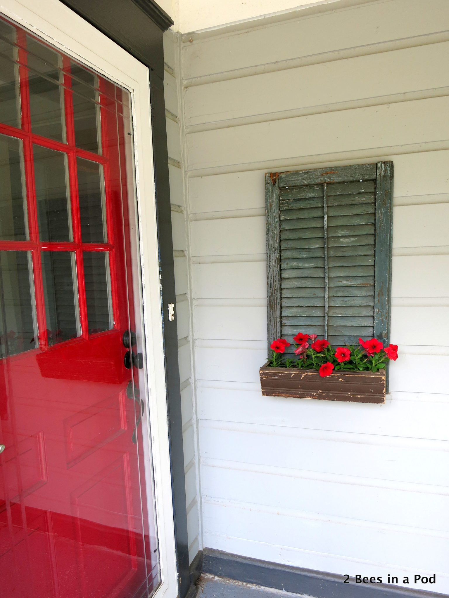 Front porch planter...trash to treasure using a shutter. Repurpose
