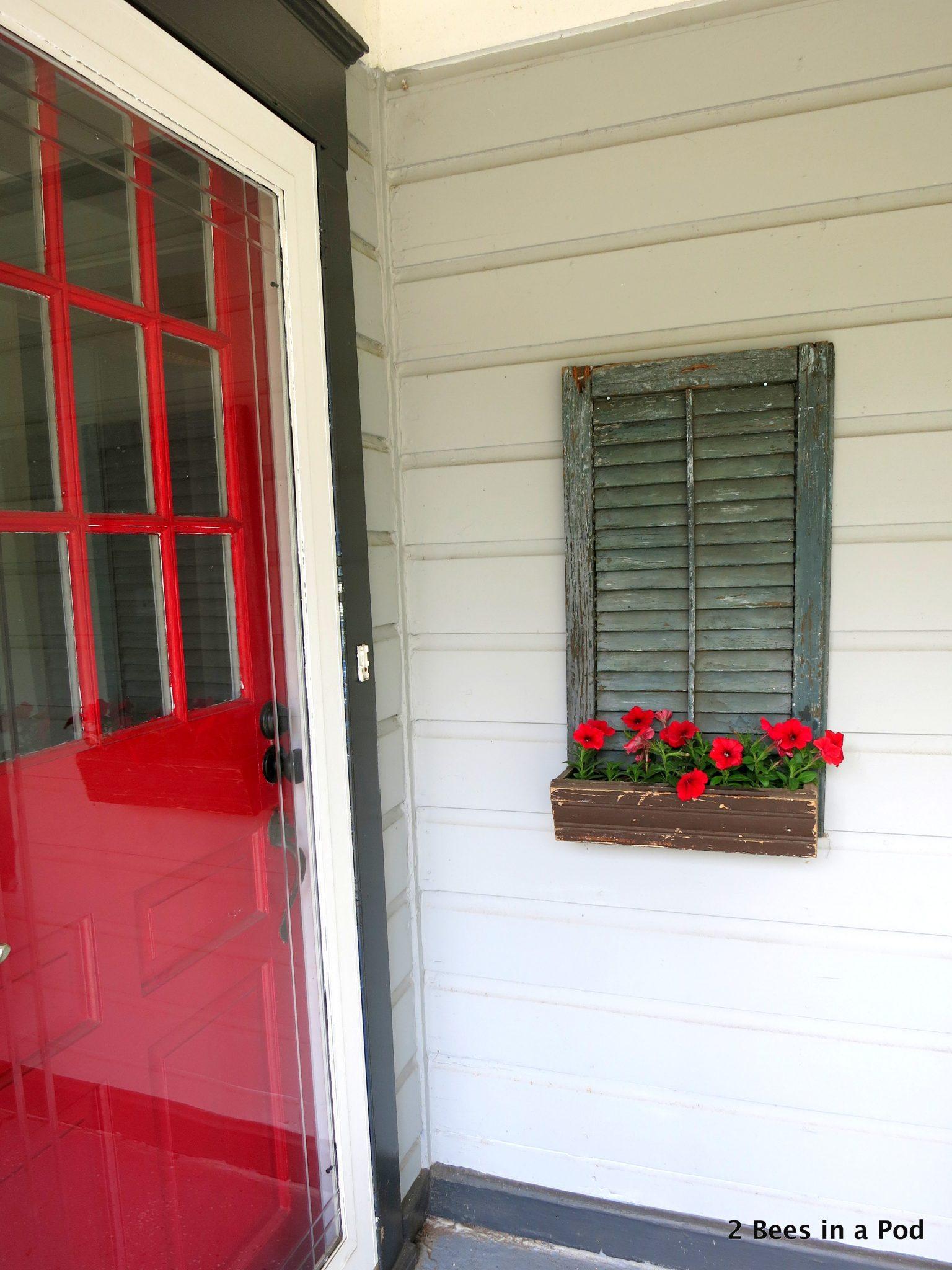 Front porch planter...trash to treasure using a shutter. Repurpose