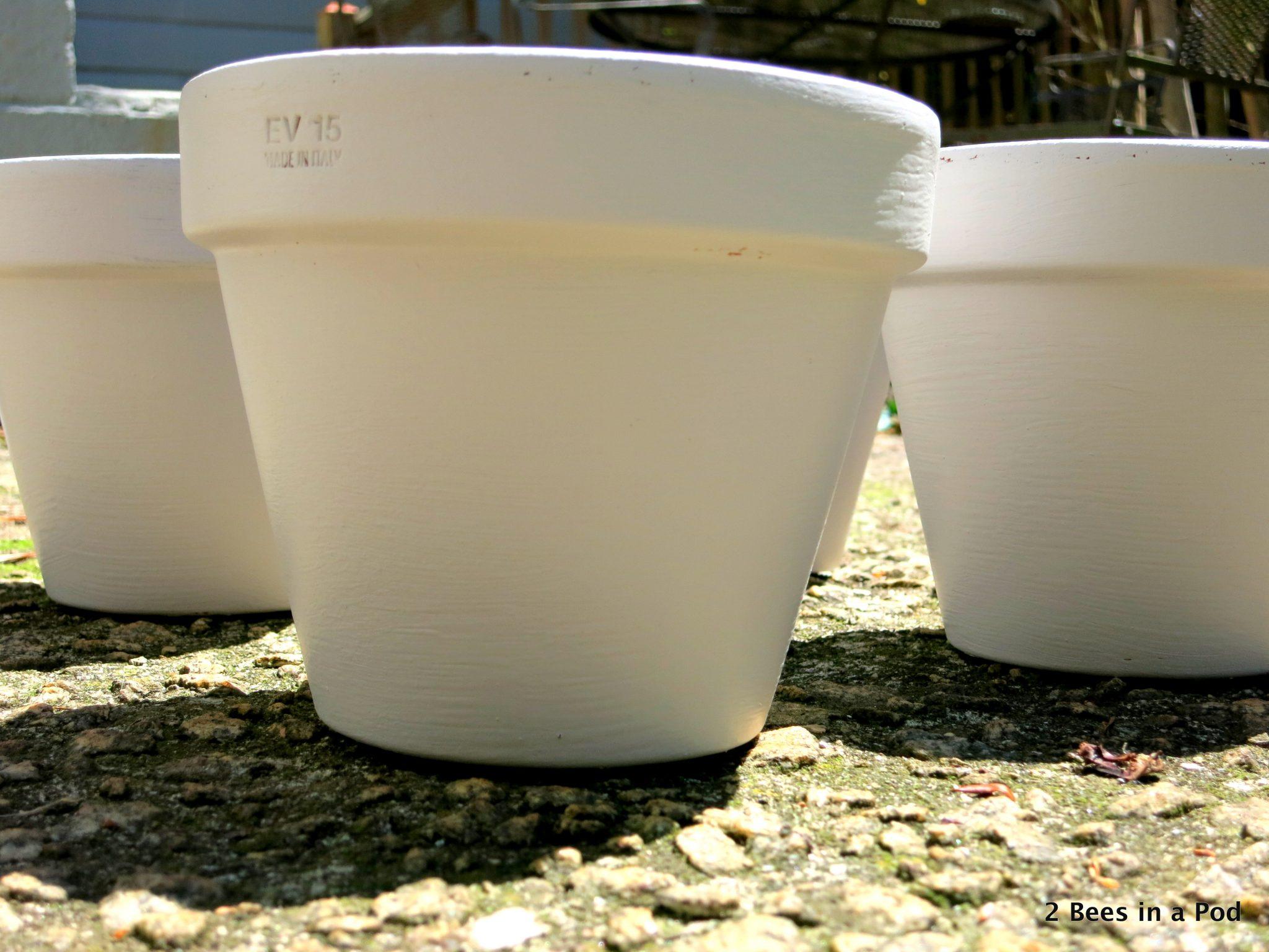 Painting terracotta pots for herb garden
