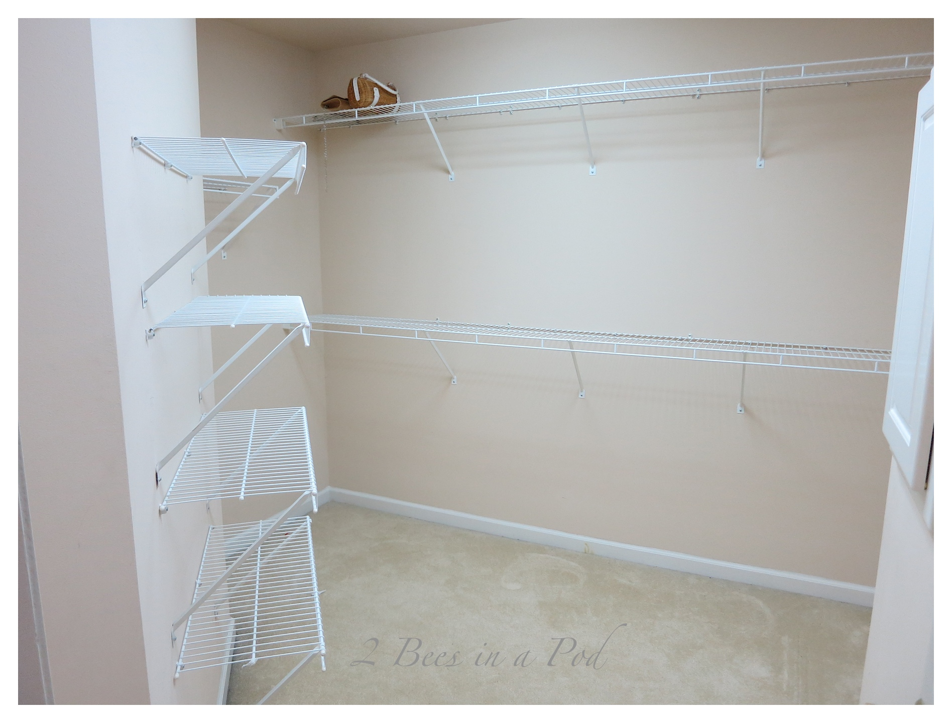Master bedroom closet makeover. See how this disorganized and messy closet was completely transformed with custom shelving, crown moulding and storage.
