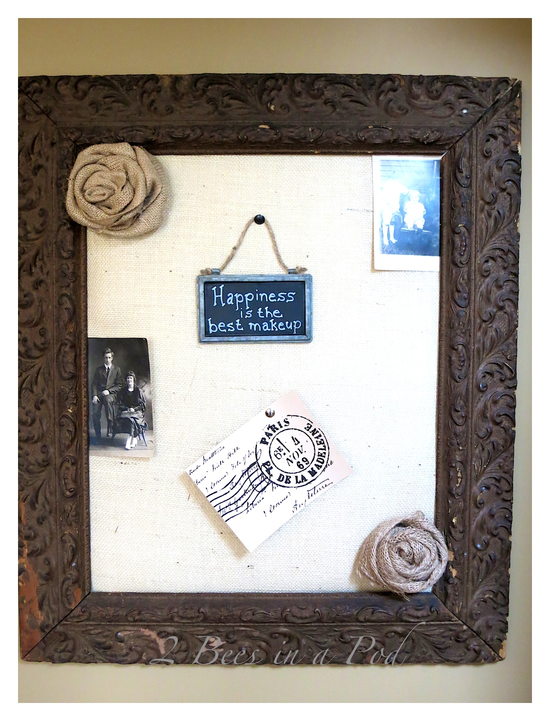 DIY burlap bulletin board. Made from a salvaged antique frame, burlap, foam board and batting. Cute decorated with vintage decor.