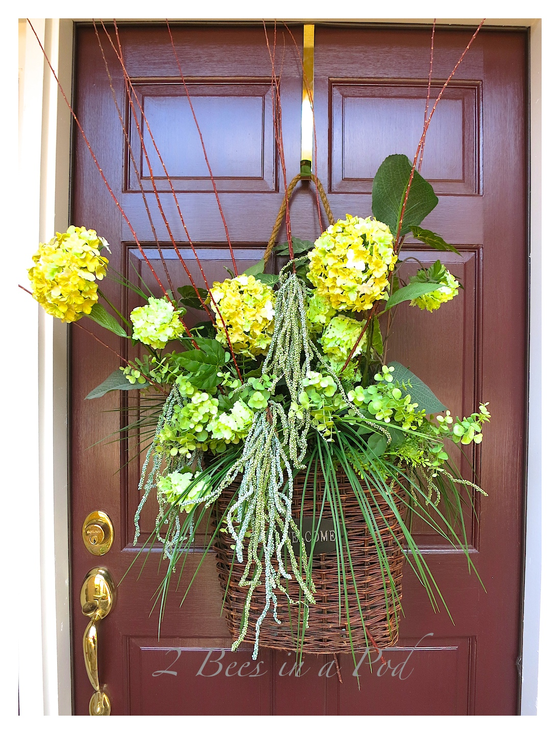 A welcome basket wreath for the front door to mark the beginning of Spring! Florals mixed with natural elements makes for a beautiful display on the front door.