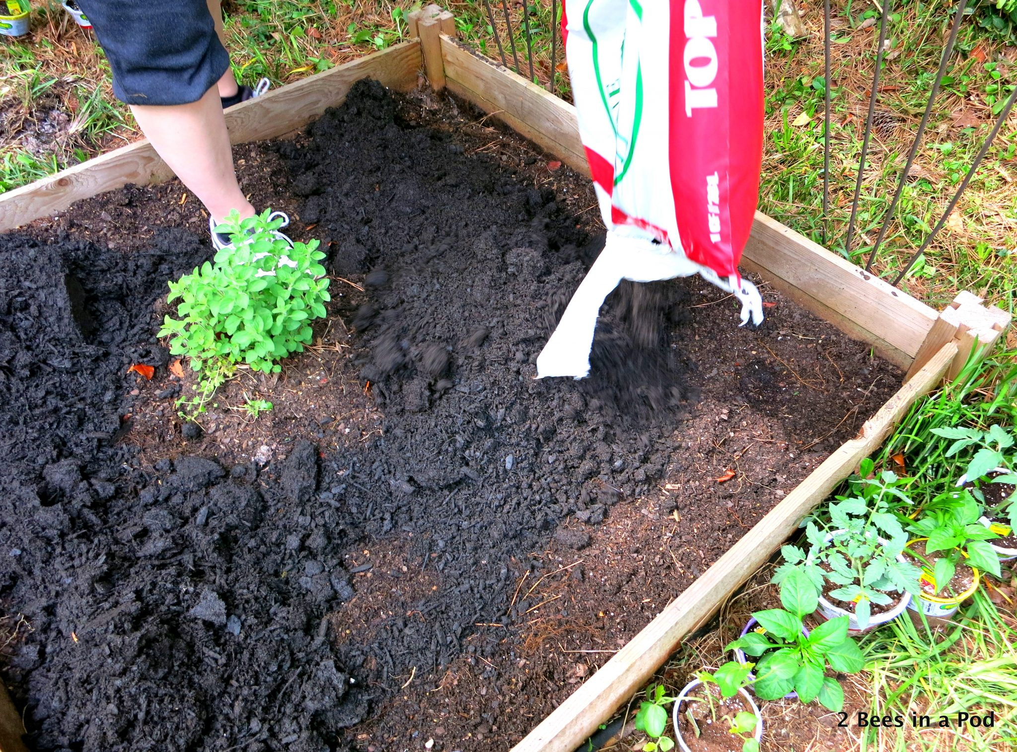 laying down soil and compost for vegetable garden