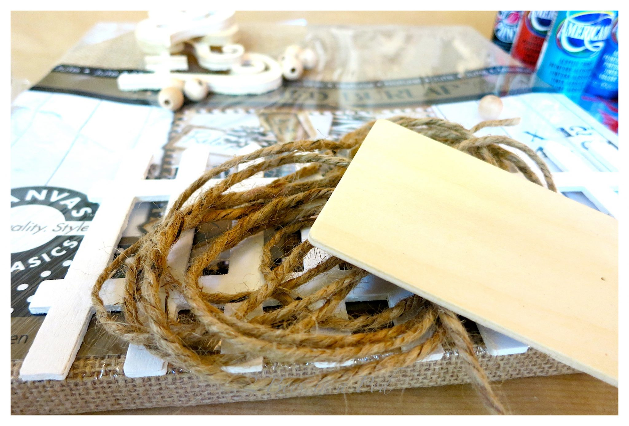 DIY Lake Wall Art - simple artwork using a wrapped burlap canvas, decorative wood pieces and paint. Ready to display your lake scene.