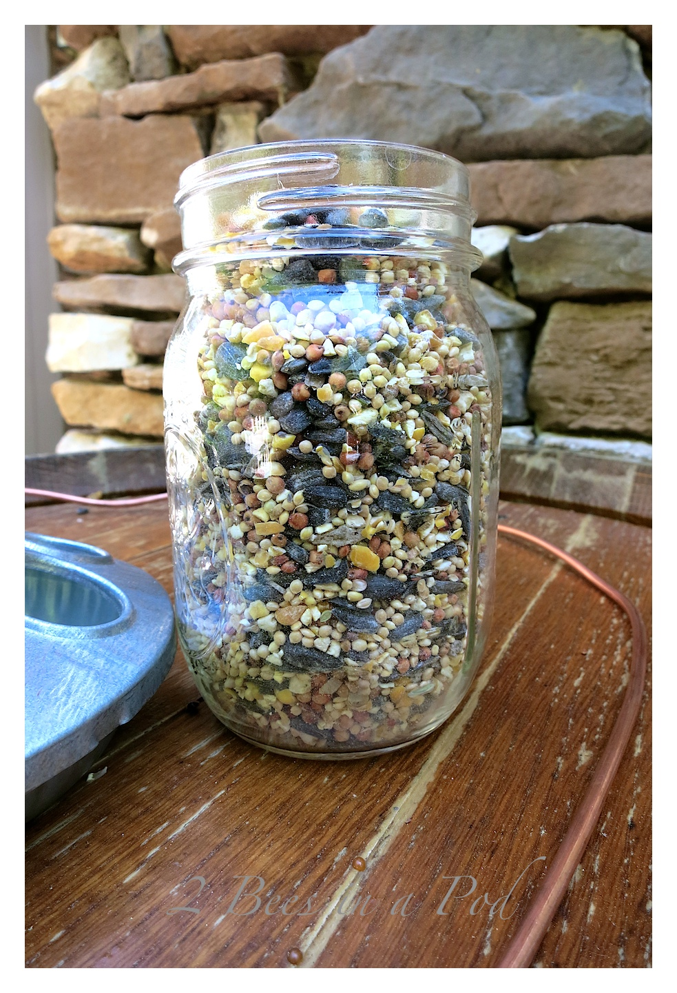 DIY birdfeeder that can be made in less than 3 minutes. All you need is a Mason jar, chicken feeder, 3 feet of 8 gauge wire and birdseed. Done :)