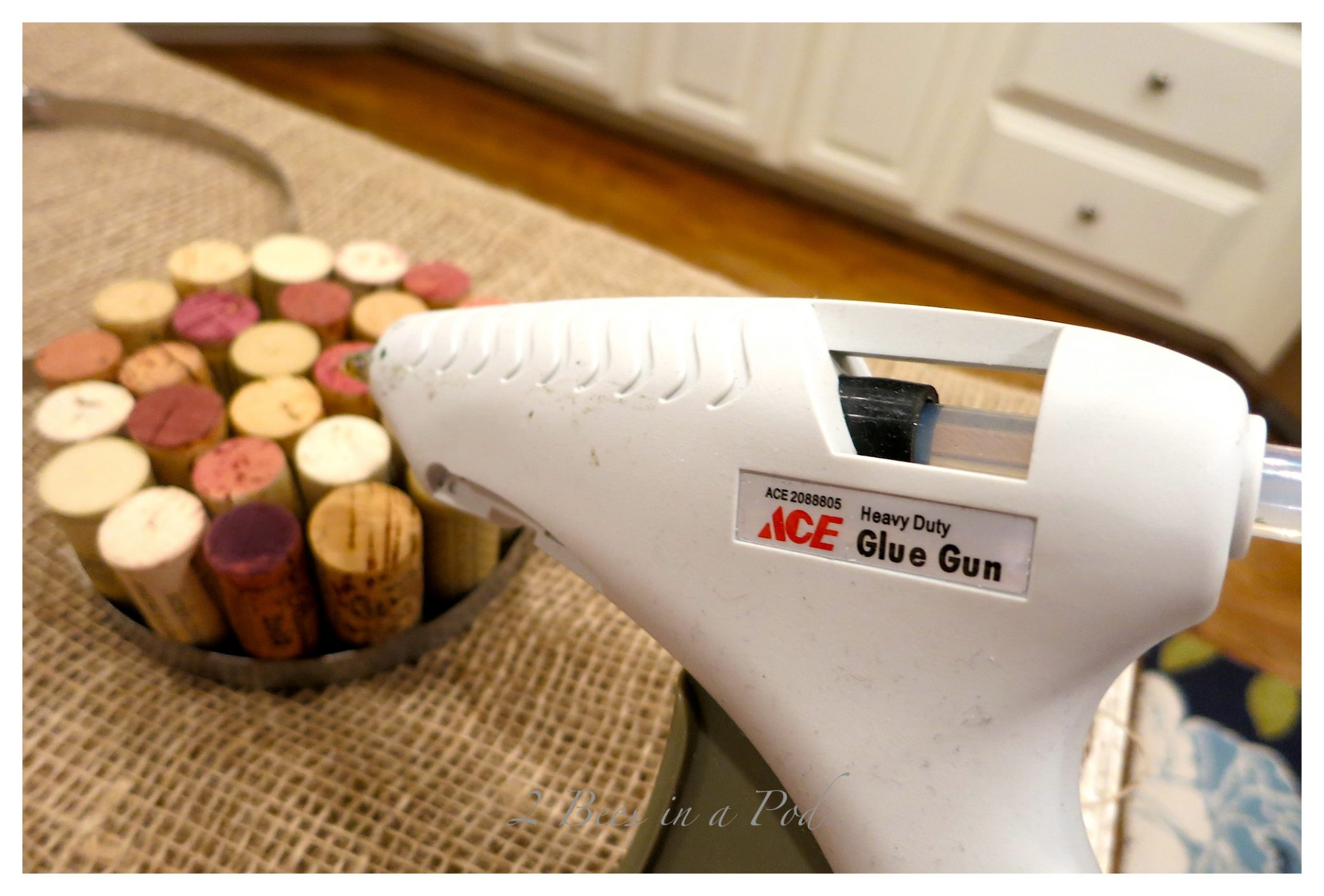 Easy DIY Wine Cork Hot Pad - just use a clamp and leftover wine cork and hot glue.