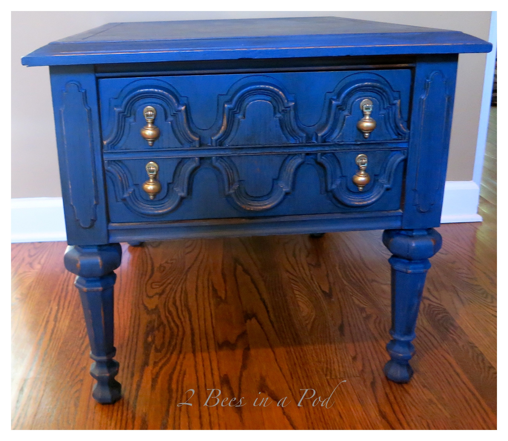 End table gets a makeover - using homemade chalk paint, light distressing and two was treatments. We even shined up the hardware using Brasso.
