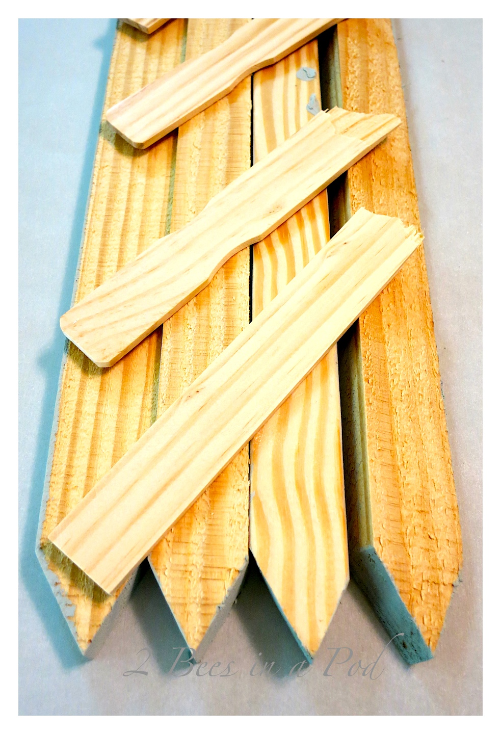 """DIY Rustic Vintage """"Lake"""" Sign - so easy to make using grade stake pickets from the hardware store. Paint and wax for an antiqued finished look."""