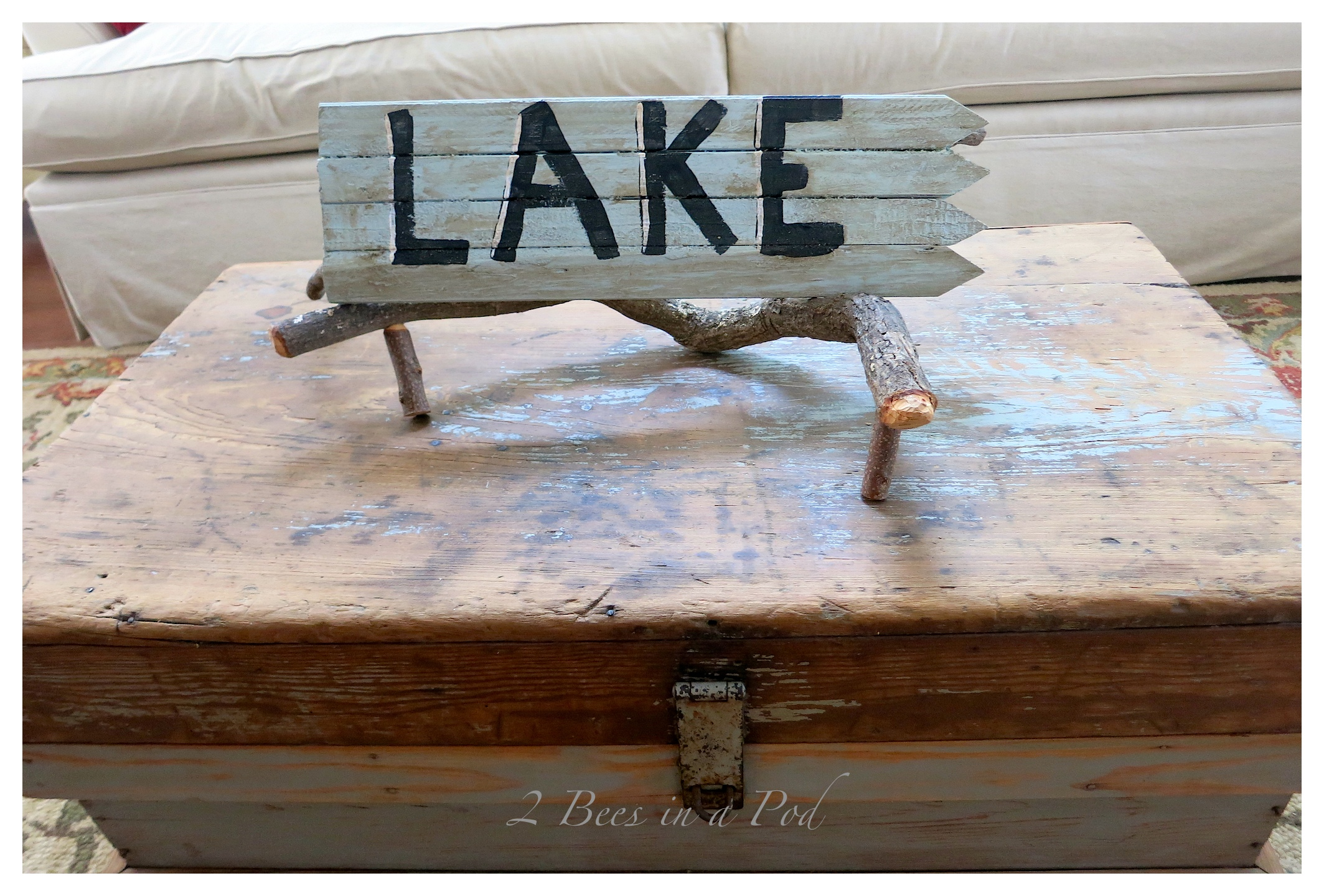 "DIY Rustic Vintage ""Lake"" Sign - so easy to make using grade stake pickets from the hardware store. Paint and wax for an antiqued finished look."