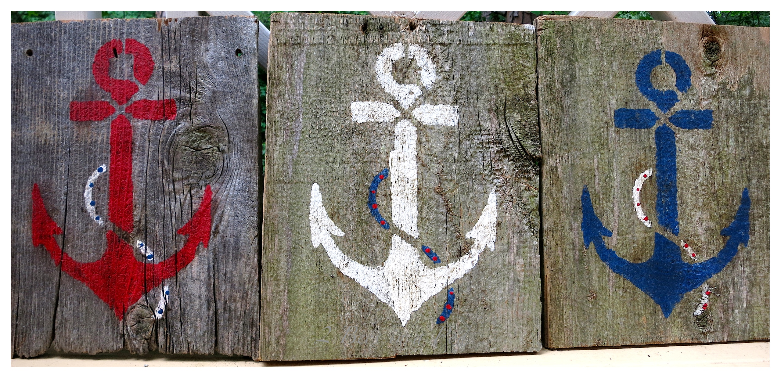 We repurposed old fencing from a friends yard. One of the projects that we did was create patriotic Americana nautical art. We stenciled red, white and blue anchors and then distressed and antiqued the wood.