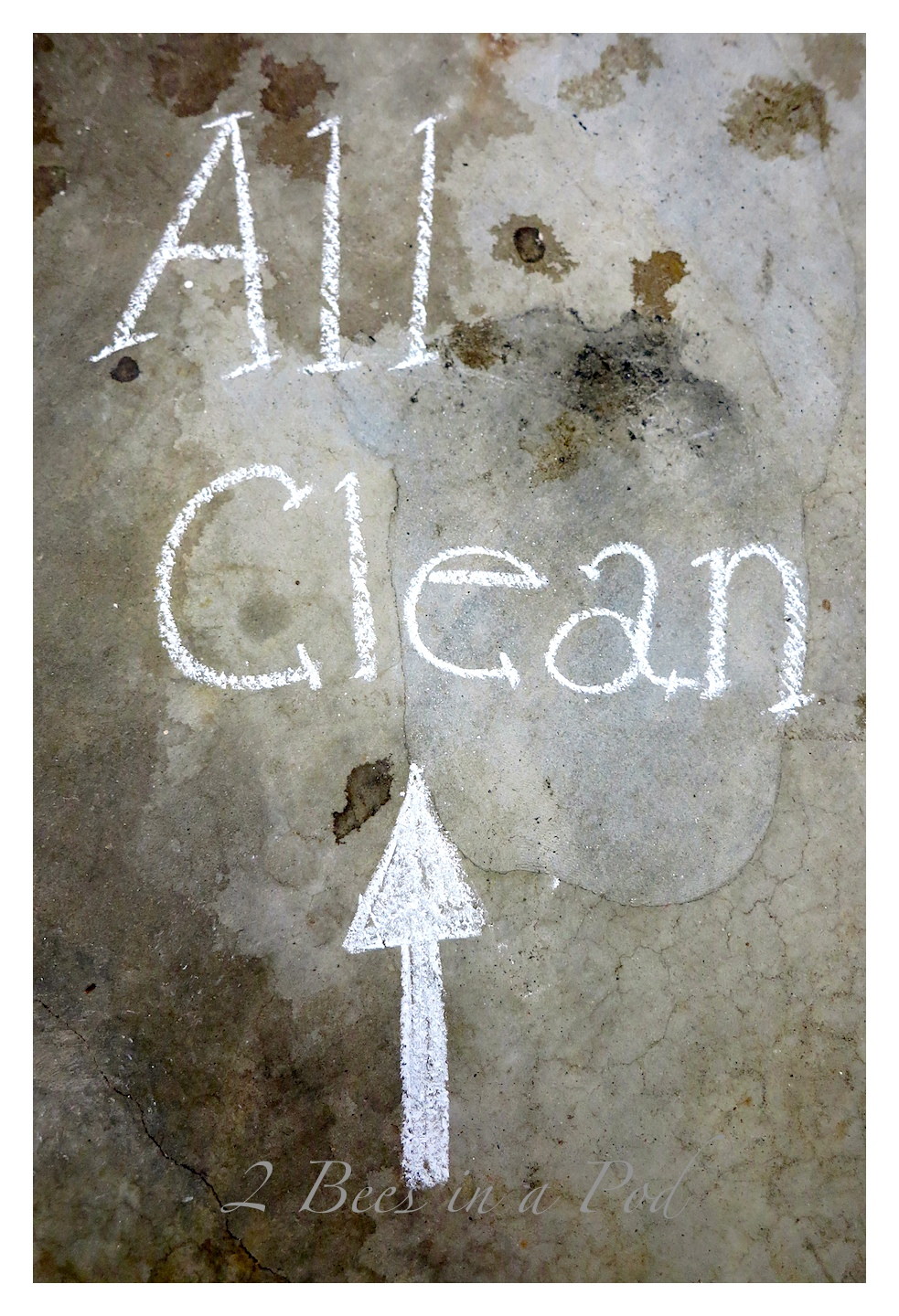 How to clean up spilled chalkboard paint off of concrete.