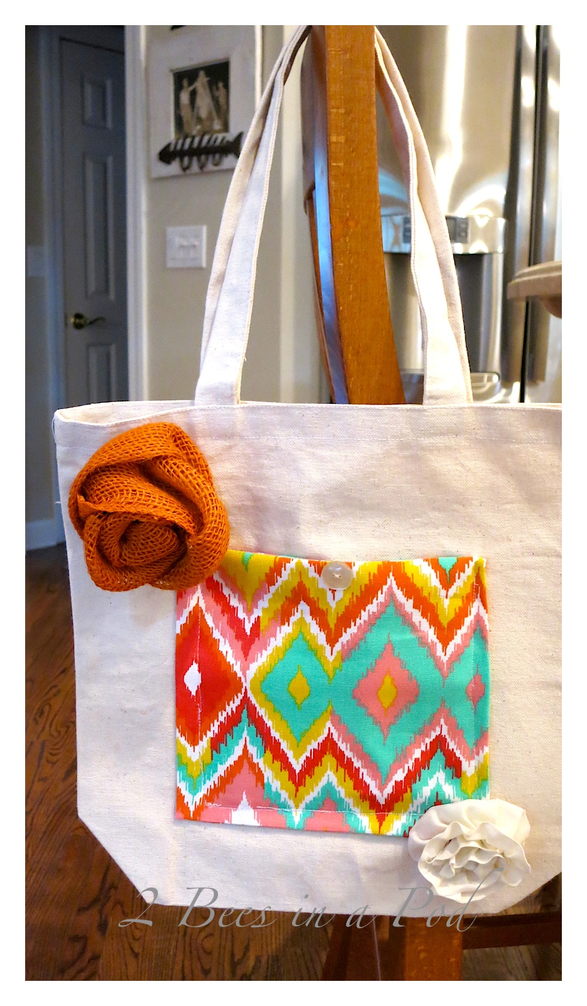 Easy DIY decorative canvas bag. Add a pocket on the fron for a pop of color. Also added a vintage button and handmade orange burlap rose and muslin rose.