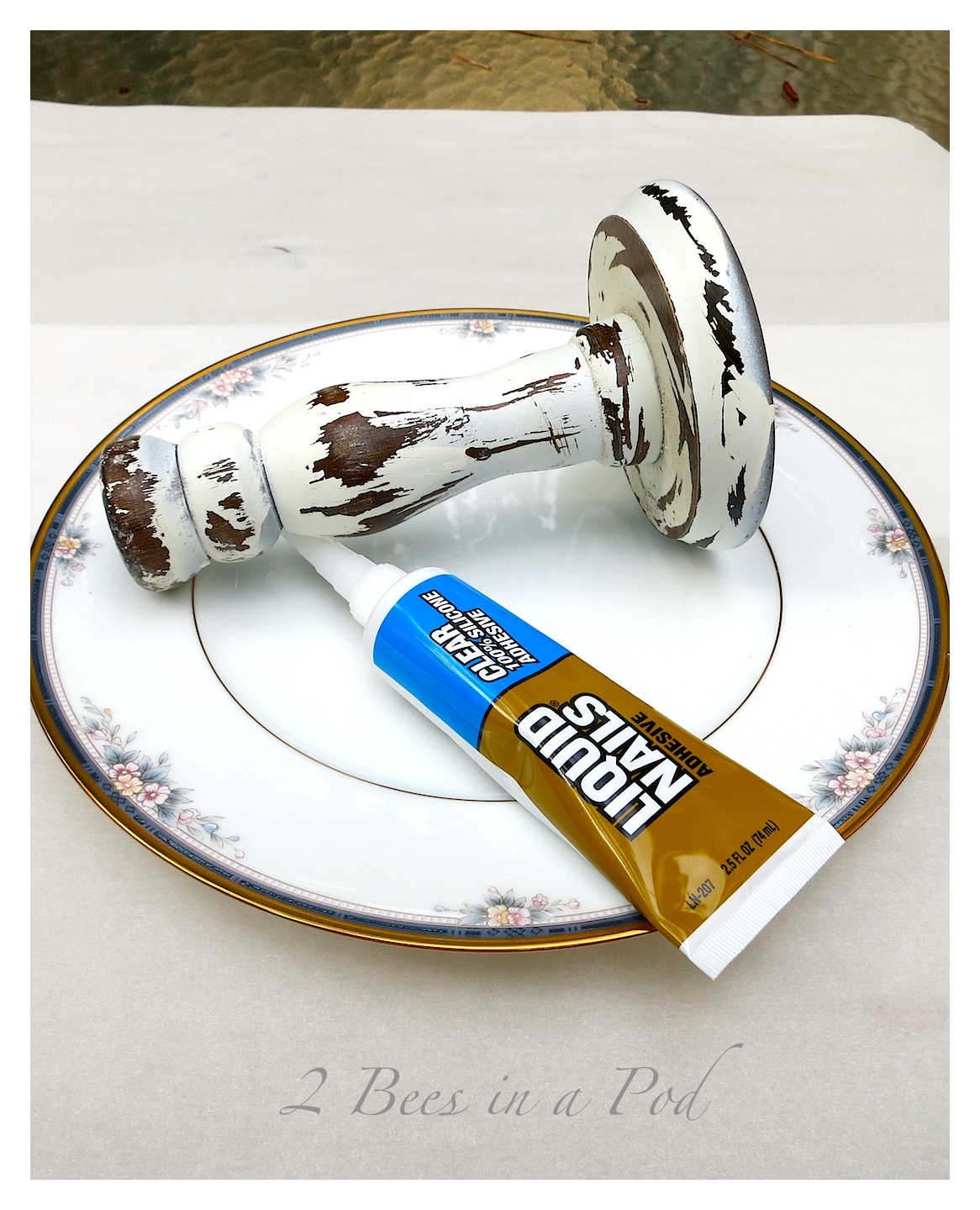 DIY rustic candlestick and vintage china plate create a decorative cake plate. Super easy and quick project. Take one candlestick, and a small amount of silicone and put the plate on top - that's it!