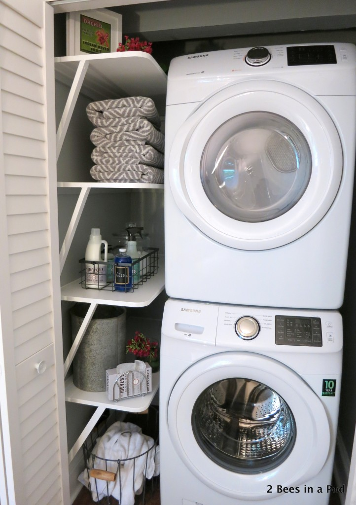 Staying organized was partly the motivation behind the laundry closet makeover. With the custom shelves, stackable unit, and other elements, this small space makes a big impact.