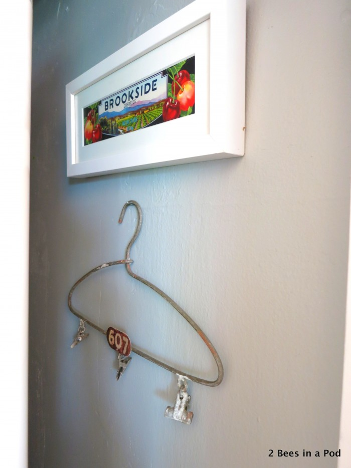 The laundry closet is small, but we wanted to incorporate a little character into the space. We decided to use a little bit of color to brighten it up, as well as this great coat hanger we got from the Country Living Fair.
