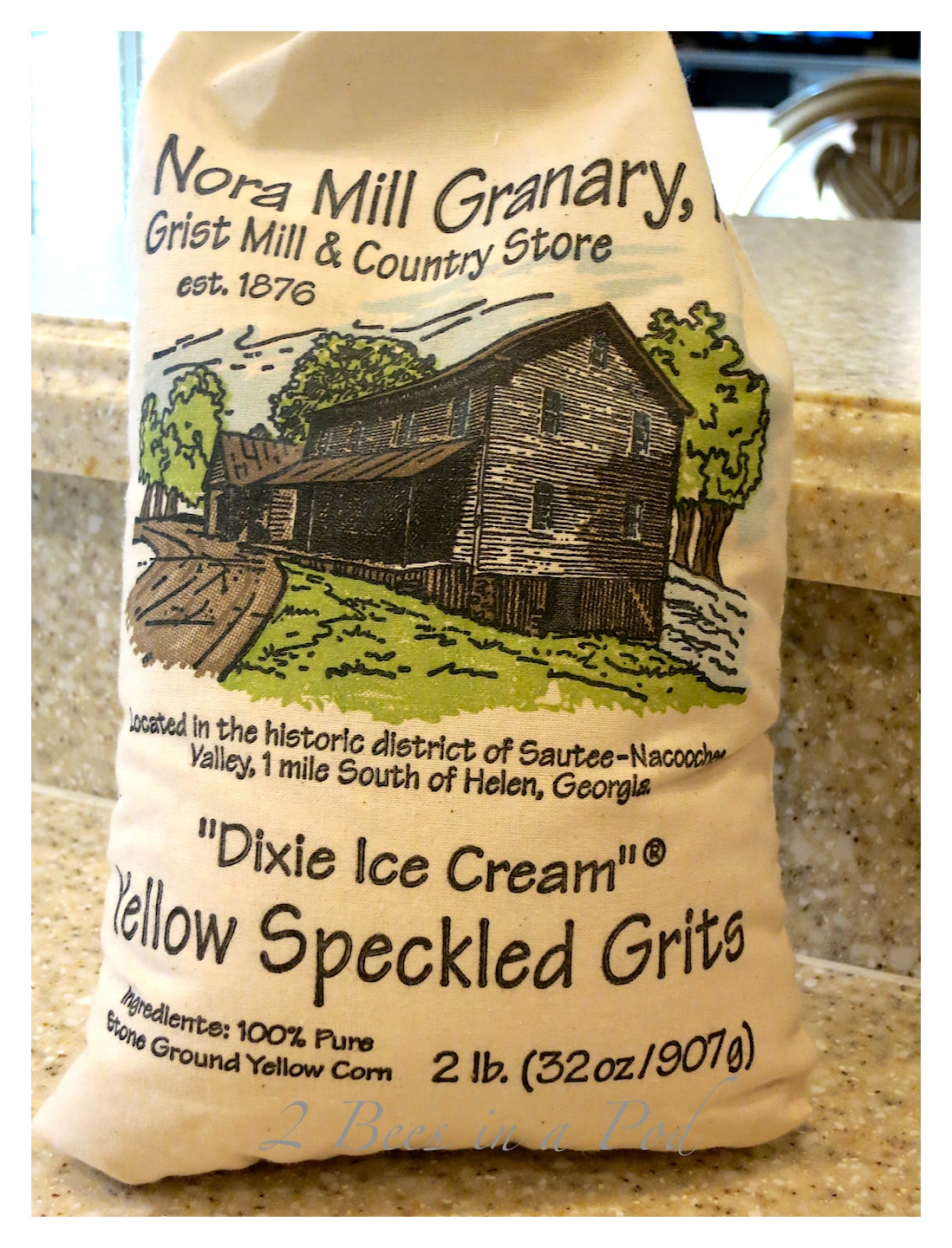 "Decadent parmesan cheese grits. The speckled yellow grits from Nora Mill Granary are known as ""Dixie Ice Cream"". Cooked on water and half and half make these grits super creamy."